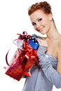 Woman with many christmas present boxes Stock Photography