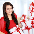 Woman with many gift box in the couch Royalty Free Stock Photos