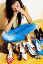 Woman with many shoes to choose from Stock Photography