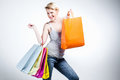 Woman with many shopping bags grey background Stock Photography