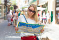 Woman with map in the street. Royalty Free Stock Photo
