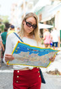 Woman with a map in the street. Royalty Free Stock Photo