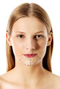 Woman marked out for cosmetic surgery. Isolated on white. Royalty Free Stock Photo