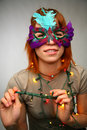Woman in mask with garland Stock Photography