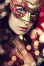 Woman in masquerade mask portrait of a beautiful the close up Royalty Free Stock Photo