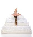 Woman and mattress portrait of a lying on many mattresses orthopedic Royalty Free Stock Photo