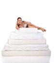 Woman and mattress portrait of a lying on many mattresses orthopedic Stock Photo