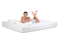 Woman and mattress portrait of a lying on a orthopedic Royalty Free Stock Image