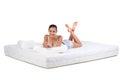 Woman and mattress Royalty Free Stock Photo