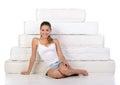 Woman and mattress portrait of a sitting near many mattresses orthopedic Stock Photo