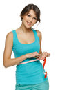 Woman measuring her waist with a measuring tape Royalty Free Stock Photos
