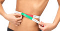 Woman measuring her waist with measuring tape health dieting and fitness concept close up of Royalty Free Stock Photos