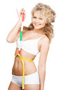 Woman measuring her waist with tape health beauty weightloss diet concept Stock Photography
