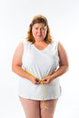 Woman measuring her waist with tape obese and is unhappy Royalty Free Stock Photography