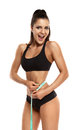 Woman measuring the hips beautiful young her thin waist Royalty Free Stock Photo