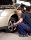 Woman Mechanic Tire Change Stock Photography
