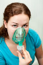 Woman in medical inhalation mask Royalty Free Stock Photography