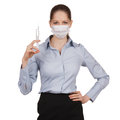 Woman in medical mask with syringe strict Royalty Free Stock Photos