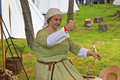 Woman in medieval setting and costume spinning yarn participant at the fayre one of the most popular annual events of the tatton Stock Image