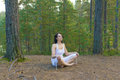 Woman meditate in forest the Stock Images