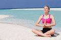Woman meditating on beautiful beach relaxing Stock Images