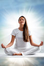 Woman meditating close up portrait of attractive young with eyes closed front view of dressed in white in yoga position with Royalty Free Stock Photos