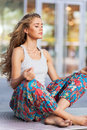 Woman meditating doing yoga with her legs crossed Royalty Free Stock Photos