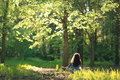 Woman meditating in forest spring Royalty Free Stock Photo