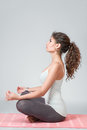 Woman meditating in lotus position young doing yoga and Stock Photos