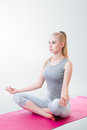 Woman meditating in lotus position young doing yoga and Stock Photography