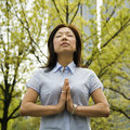 Woman meditating outdoors Royalty Free Stock Photos