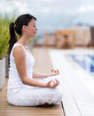 Woman meditating outdoors sitting in a yoga position Royalty Free Stock Photos