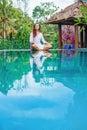 Woman meditating at pool side Royalty Free Stock Photo