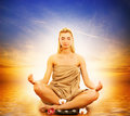 Woman meditating in a sea Royalty Free Stock Image