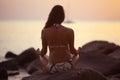 Woman meditating on  sea beach Royalty Free Stock Photo