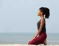 Woman meditating at the seaside side view portrait of a young Royalty Free Stock Photo