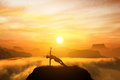 Woman meditating in side balance yoga position on the top of a mountains above clouds at sunset zen meditation peace Royalty Free Stock Photo