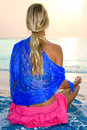 Woman meditating on tropical beach Stock Images