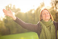 Woman meditating or worshiping in autumn happy young with open arms a park simply enjoying the season Stock Photography