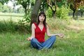 Woman meditation caucasian brunette in pose outdoors Royalty Free Stock Photos