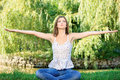Woman at meditation outdoor young in lotus pose the Stock Image