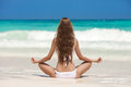 Woman meditation at tropical beach young Stock Images