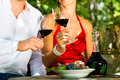 Woman men vineyard drinking red wine sunshine clinking glasses Royalty Free Stock Photo