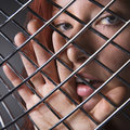 Woman through metal pattern. Stock Photography