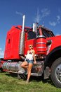 Woman and mighty truck in denim shorts standing in front of a powerful pictured in new zealand Royalty Free Stock Image