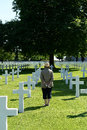 Woman in military cemetery old stood between war graves american brittany france Royalty Free Stock Photos