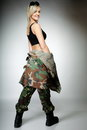 Woman in military clothes army girl full length on gray background Royalty Free Stock Photography