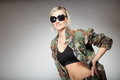 Woman in military clothes army girl with sunglasses on gray background Royalty Free Stock Photos