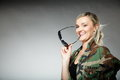 Woman in military clothes army girl with sunglasses on gray background Stock Images