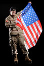 Woman in military uniform with flag in the hands Royalty Free Stock Photos